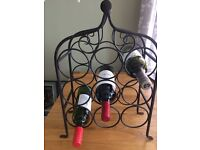 Attractive wrought iron wine rack holds 9 bottles