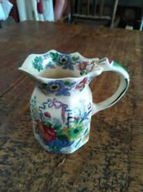 Antique milk jug