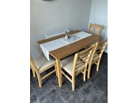 Dining table and 4 chairs. REDUCED AGAIN FOR QUICK SALE.