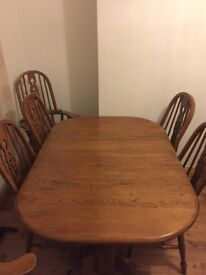 Oak table and chairs, with two extensions.