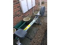 Delta rowing machine