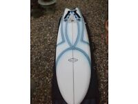 Circle one quad fin surfboard and bag