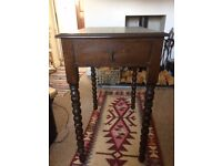 Solid dark wood table with lathed legs