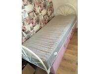 Small single white metal bed with ikea mattress