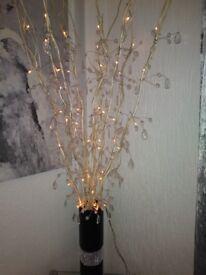 Beautiful twig lights and vase