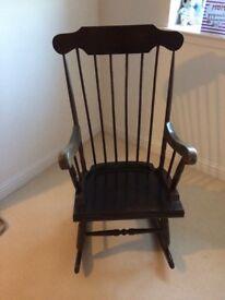 Traditional dark wooden rocking chair