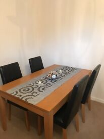 Solid dining table and four genuine leather chairs