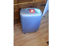 BIG Brand new silver hardshell Skyflite Elan 4 Wheel suitcase - the biggest 80cm 99lts