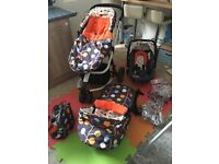 Cosatto Giggle 2 Travel System. Buggy base with car seat, carrycot, stroller, raincovers, bag.