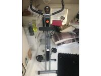 Foldaway Exercise Bike . As new £60 Ono . Unwanted gift . First to see will buy