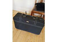 Medium black suitcase, corner wheels, good condition, hardly used.
