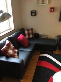 Excellent condition Faux Leather black corner sofa