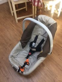 Jane - baby car seat that also lies flat in the back seat , perfect for long car journeys .