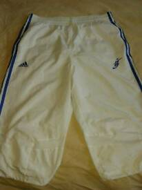 Adidas long football shorts