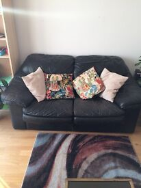 Two leather sofas (2 seater), black. Will sell separately. Dalston area.