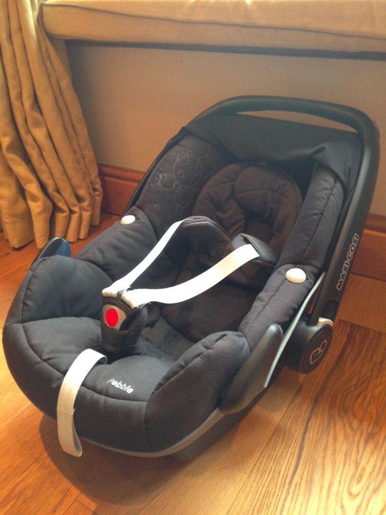Black Maxi Cosi Pebble car seat with newborn wedge and head-hugger