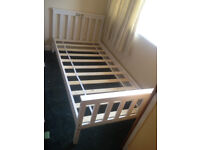 White single wooden bed