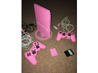 Pink PS2 with 2 pink controllers