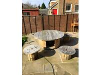 Rustic cable reel garden table and stools