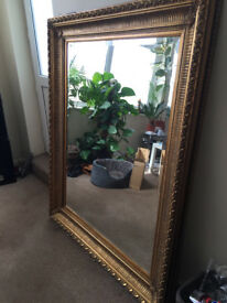 Beautiful classical large ornate gold coloured framed mirror for sale