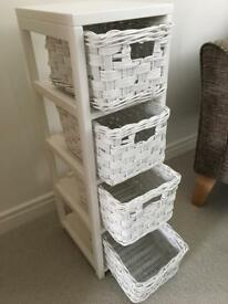 White storage unit with 4 small wicker drawers