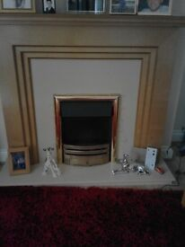 real teak fire place with electric heater