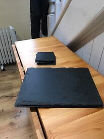 4 Solid slate placemats and 4 matching coasters.