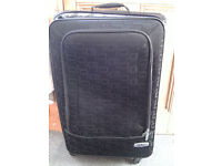 Large 'Frenzy' Suitcase. Black Fabric With Wheels & Pull up handle