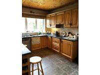 Chestnut fully fitted kitchen.