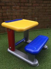 Child's desk with fixed seat