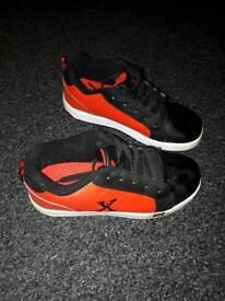 red and black Heelys