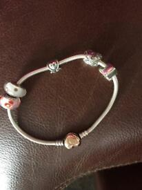 Rose gold pandora bracelet with charms