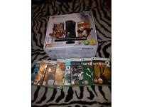 Xbox 360 with games and wired controllers