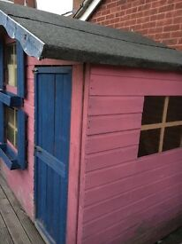 Children's two storey wooden playhouse