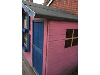Children's two storey wooden playhouse