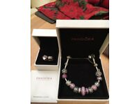 Full Pandora bracelet with extra birthday charms. All genuine with boxes. As new condition