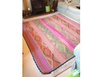 Hand woven multi-coloured rug, made in Peru