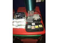 Nintendo ds with charger,case,a game case and 8 games