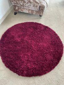 Plum round coloured rug 133cm