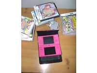 Nintendo DSI console (pink) and 12 games