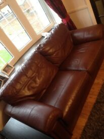 Two and three seater brown / chestnut sofa