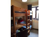 Single loft bed with integral desk and comfy chair - which folds out into second bed.