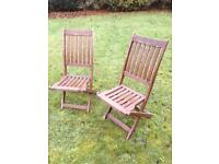 2 wooden Garden Chairs - They Fold Away