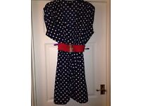 Navy polka dot dress with red belt