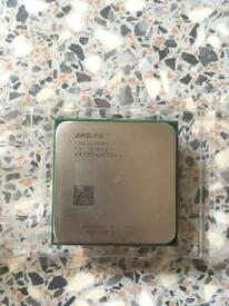 AMD Bulldozer FX-4100 CPU 3.60GHz with stock cooler.