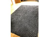 Large, charcoal coloured, shaggy rug
