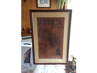 Beautiful picture 34'' x 24'' in frame. Hand painted on cowhide in Africa. Lovely warm colour