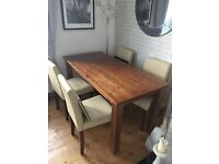 FOR SALE OAK DINING TABLE WITH 6 CREAM LEATHER CHAIRS .