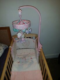 Swinging crib with mattress and playing toy.Excellent condition