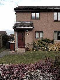 TAYPORT two bedroom top floor flat with garden and parking. quiet street.